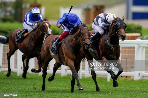 Jockey Ryan Moore riding Circus Maximus rides to win The Queen Anne Stakes from Jockey Frankie Dettori on horse Terebellum on day one of the Royal...