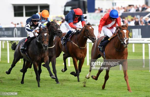 Jockey Ryan Moore riding Davydenko wins the Magners Rose Handicap during ladies day of the St Leger Festival at Doncaster Racecourse on September 12...