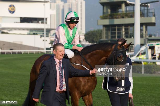 KONG DECEMBER Jockey Ryan Moore riding Deauville in the LONGINES Hong Kong Cup at the Sha Tin Racecourse during the LONGINES Hong Kong International...