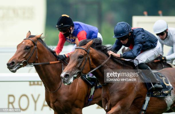 Jockey Ryan Moore riding Russian Emperor beats The Queens horse First Receiver ridden by Frankie Dettori to win the Hampton Court Stakes on day two...