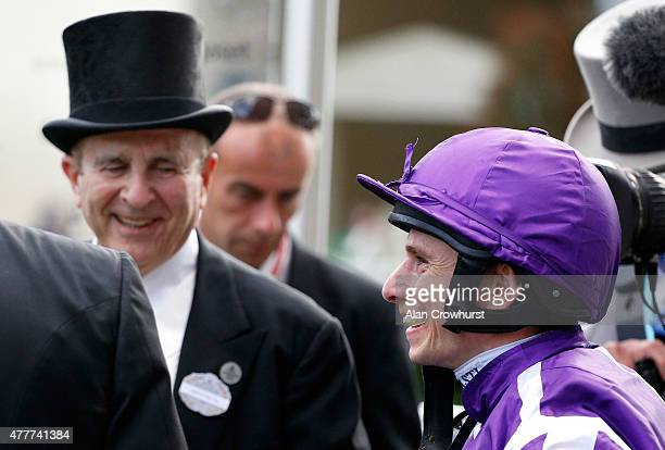 Jockey Ryan Moore smiles as he celebrates after winning the Queen's Vase taking a record ninth victory at the royal meeting during Royal Ascot 2015...