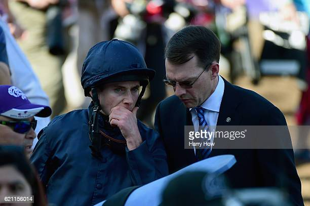 Jockey Ryan Moore talks trainer Aidan O'Brien before the Breeders' Cup Juvenile Turf during day one of the 2016 Breeders' Cup World Championships at...