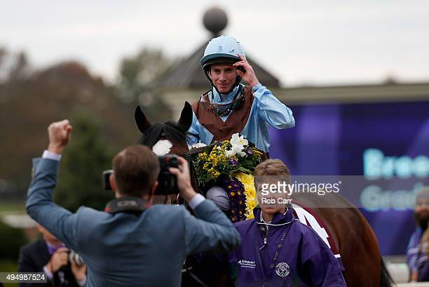 Jockey Ryan Moore tips his hat after riding Hit It A Bomb to win the Breeder's Cup Juvenile Turf at Keeneland Racecourse on October 30 2015 in...