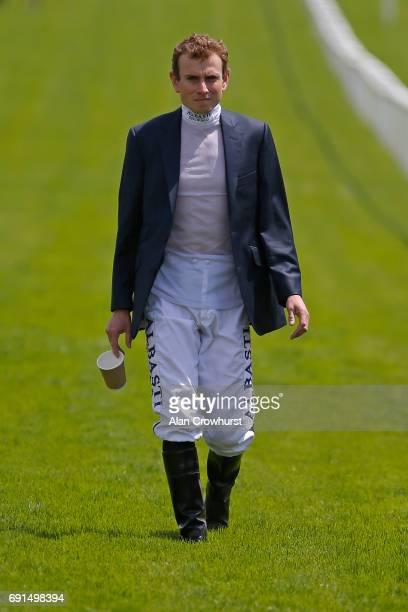Jockey Ryan Moore walks the course on Ladies Day at Epsom Racecourse on June 2 2017 in Epsom England