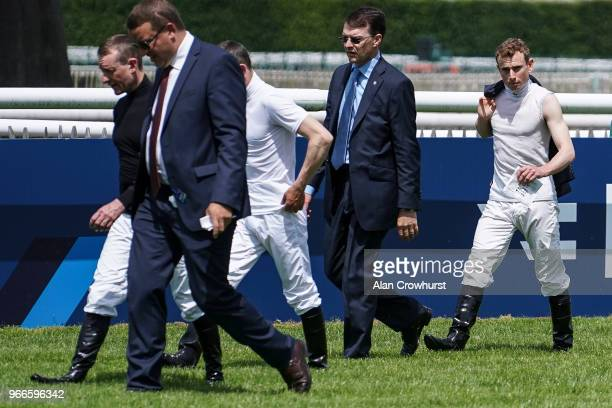 Jockey Ryan Moore with trainer Aidan O'Brien walk the course during the Prix du Jockey Club meeting at Hippodrome de Chantilly on June 3 2018 in...