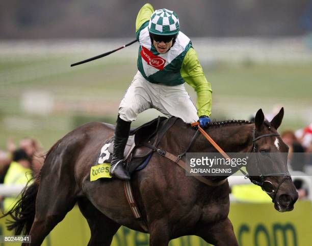 Jockey Sam Thomas rides Denman up the final straight to victory in The Totesport Cheltenham Gold Cup steeple chase race during the fourth day of the...