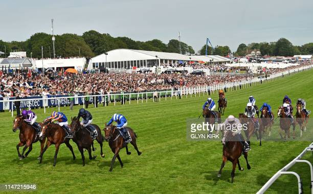 Jockey Seamie Heffernan rides Anthony Van Dyck to victory in the Derby Stakes on the second day of the Epsom Derby Festival in Surrey, southern...