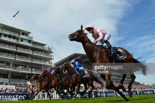 Jockey Seamie Heffernan rides Anthony Van Dyck to victory in the Derby Stakes on the second day of the Epsom Derby Festival in Surrey southern...