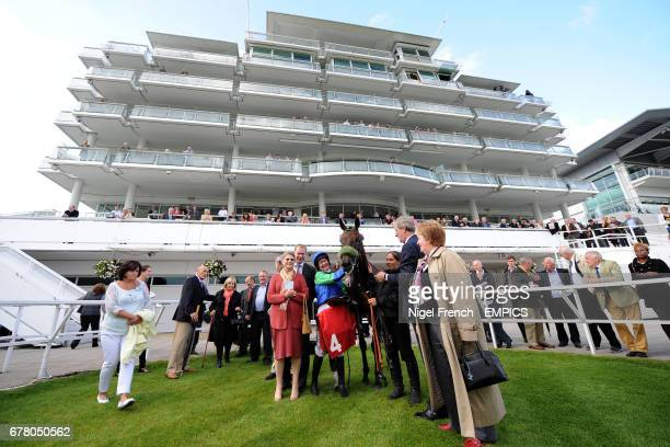 Jockey Serena Brotherton poses with Epsom Salts in the winner's enclosure after winning the May Family Ladies' Derby Handicap