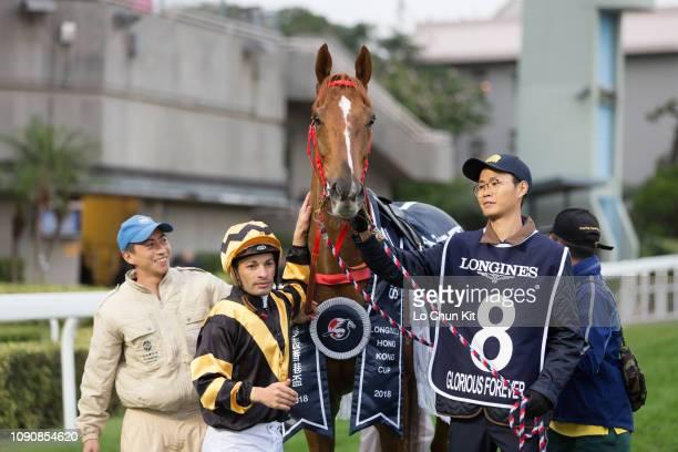 Jockey Silvestre De Sousa celebrates after Glorious Forever winning Race 8 Longines Hong Kong Cup during the LONGINES Hong Kong International Races...