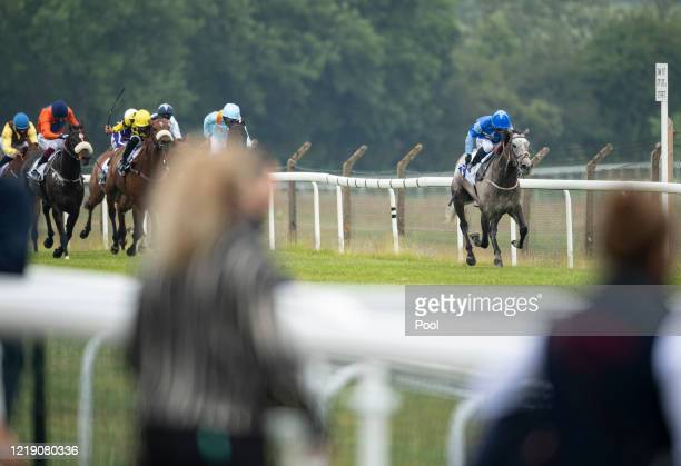 Jockey Silvestre De Sousa onboard Angels Whisper wins the 1m Constant Security Keeping Yorkshire Safe Handicap at Pontefract Racecourse on June 10,...