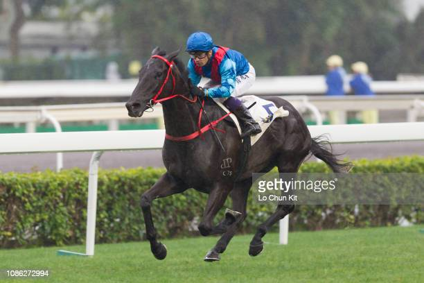 Jockey Silvestre De Sousa riding Dark Dream wins Race 7 Long Ke Handicap at Sha Tin racecourse on December 23, 2018 in Hong Kong. Dark Dream is...