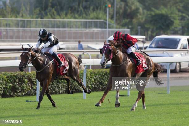 Jockey Silvestre De Sousa riding Eagle Way wins Race 7 The Bochk Jockey Club Cup at Sha Tin racecourse on November 18, 2018 in Hong Kong. Jockey...