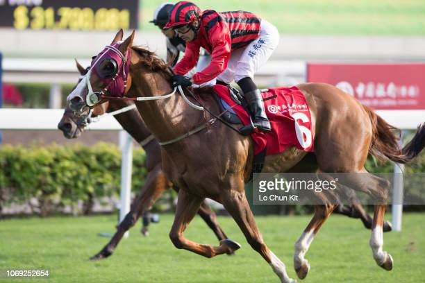 Jockey Silvestre De Sousa riding Eagle Way wins Race 7 The Bochk Jockey Club Cup at Sha Tin racecourse on November 18, 2018 in Hong Kong.