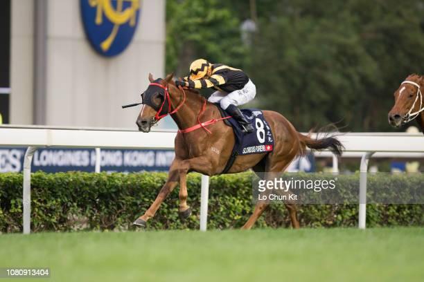 Jockey Silvestre De Sousa riding Glorious Forever wins Race 8 Longines Hong Kong Cup during the LONGINES Hong Kong International Races Day at Sha Tin...