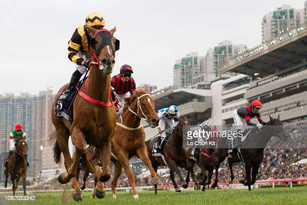 Jockey Silvestre De Sousa riding Glorious Forever wins Race 8 Longines Hong Kong Cup during the LONGINES Hong Kong International Races Day at Sha Tin...