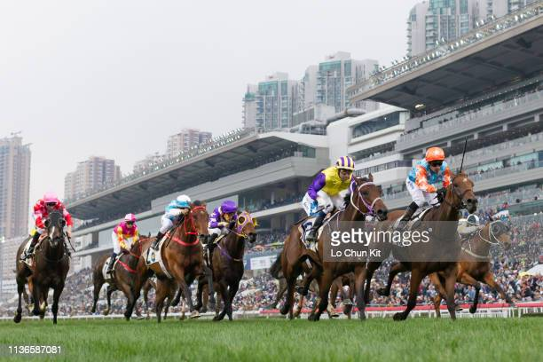 Jockey Silvestre De Sousa riding Super Star wins the Race 9 Luger Handicap at Sha Tin Racecourse on March 17, 2019 in Hong Kong. Invincible Missile...