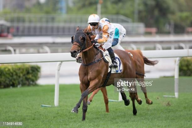Jockey Silvestre De Sousa riding Wishful Thinker wins the Race 1 Flamingo Flower Handicap at Sha Tin Racecourse on March 10, 2019 in Hong Kong.