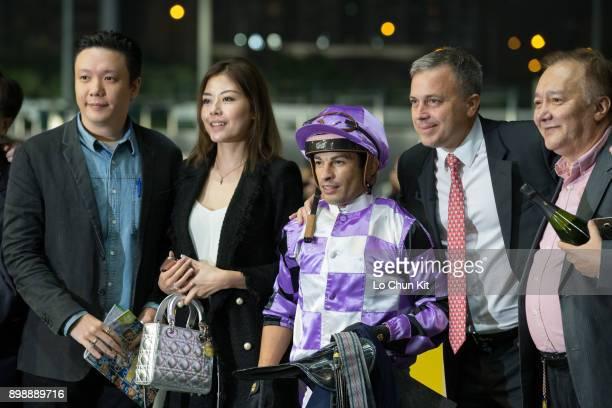 Jockey Silvestre De Sousa trainer Caspar Fownes and owners celebrate after Peace Combination wins the Race 5 Longines International Jockeys'...