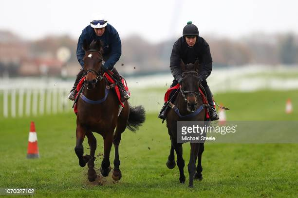 Jockey Stan Sheppard riding Thomas Patrick trained by Tom Lacey alongside Templeross during gallops ahead of the Ladbrokes Winter Carnival meeting at...