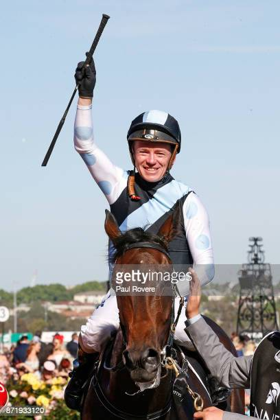 Jockey Stephen Baster celebrates as he returns to scale after winning race 8 the Kennedy Oaks on Pinot on 2017 Oaks Day at Flemington Racecourse on...