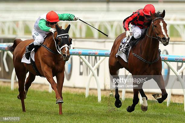 Jockey Stephen Baster rides Mujadale to win race two the BMW Handicap during Thousand Guineas Day at Caulfield Racecourse on October 16 2013 in...