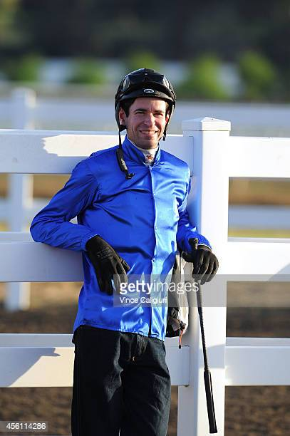 Jockey Steven Arnold waiting for the morning barrier trials to begin at Flemington Racecourse on September 26 2014 in Melbourne Australia
