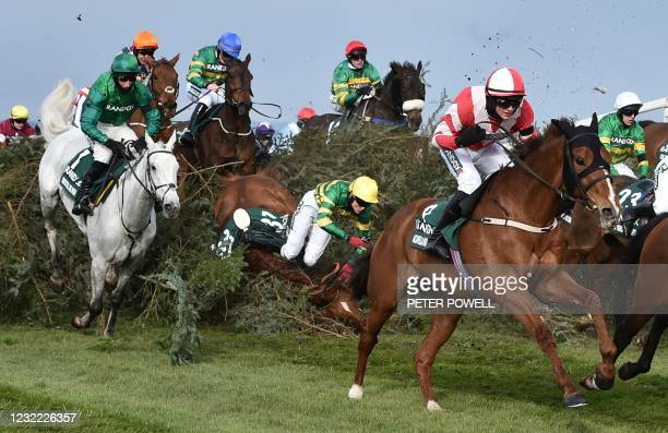 Jockey Thomas Bellamy riding Canelo falls at 'The Chair' fence in the Grand National Handicap Chase on Grand National Day of the Grand National...