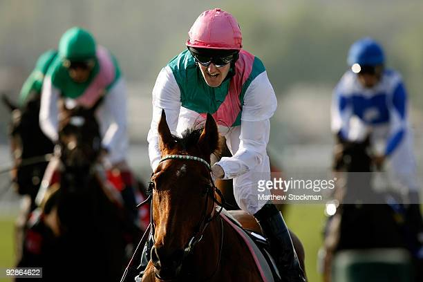 Jockey Thomas Queally rides Midday en route to winning the Breeders' Cup Juvenile Filly and Mare Turf race during the Breeders' Cup World...