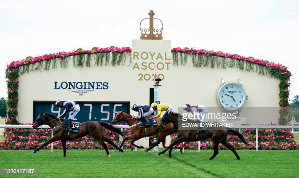 Jockey Thore Hammer Hansen rides home Coeur De Lion to win the ridden by win the Ascot Stakes race on day one of the Royal Ascot horse racing meet in...