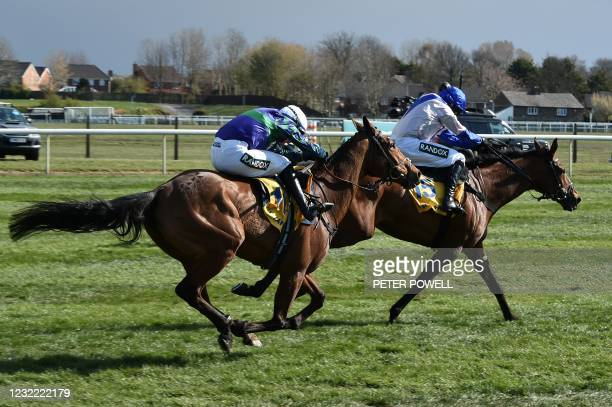 Jockey TJ O'Brien rides 'Thyme Hill' to win the Ryanair Stayers Hurdle race on Grand National Day of the Grand National Festival at Aintree...
