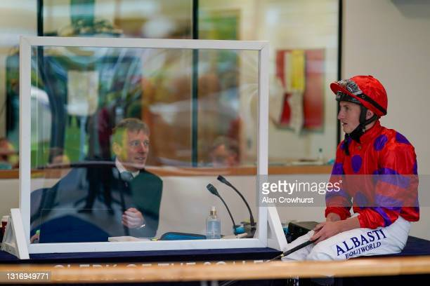 Jockey Tom Marquand chats with Clerk of the Scales Graham Ford at Ascot Racecourse on May 08, 2021 in Ascot, England. Only owners are allowed to...