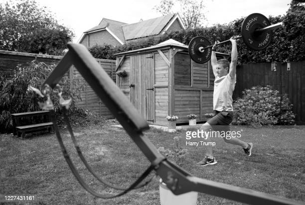 Jockey Tom Marquand works out from home as he lifts weights on May 27 2020 in Hungerford England