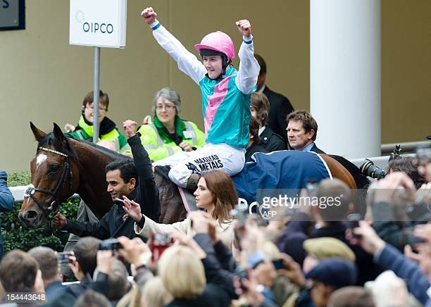 Jockey Tom Queally gestures to the crowd as he rides racehorse Frankel following the Champion Stakes British Champions Middle Distance race at Ascot...