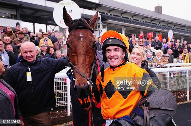 Jockey Tom Scuadmore poses with Thistlecrack after winning the Aspen Waite Complete Business Growth Service Novices Steeple Chase at Chepstow...