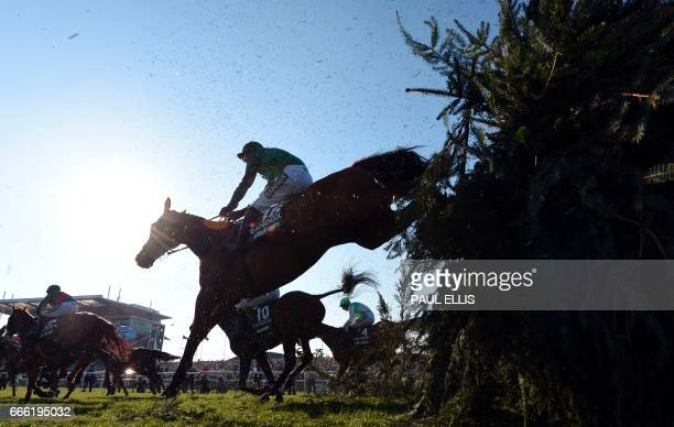 Jockey Tom Scudamore riding Vieux Lion Rouge jumps 'The Chair' during the Grand National horse race on the final day of the Grand National Festival...