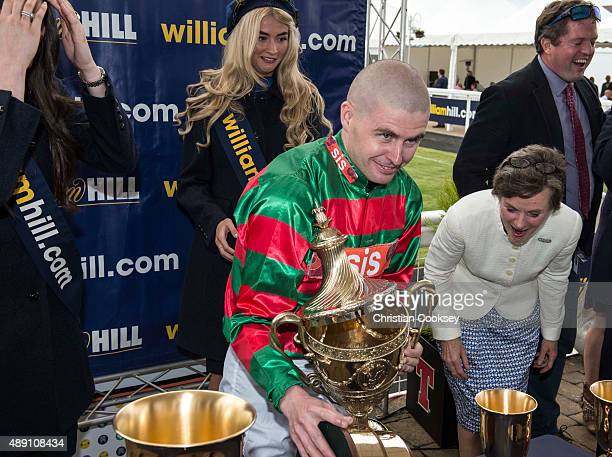 Jockey Tony Hamilton drops the Gold Cup after riding Don't Touch to victory in the William Hill Ayr Gold Cup on September 19 2015 in Ayr Scotland