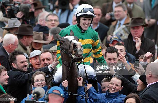 Jockey Tony McCoy celebrates his win on Synchronised the winner of the Cheltenham Gold Cup at the Cheltenham Festival 2012 on March 16 2012 in...