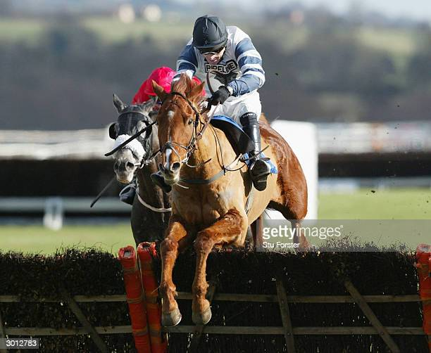 Jockey Tony McCoy comes over the last fence on Jardin Fleuri on his way to winning his first race on his comeback during The Corve Novices Selling...