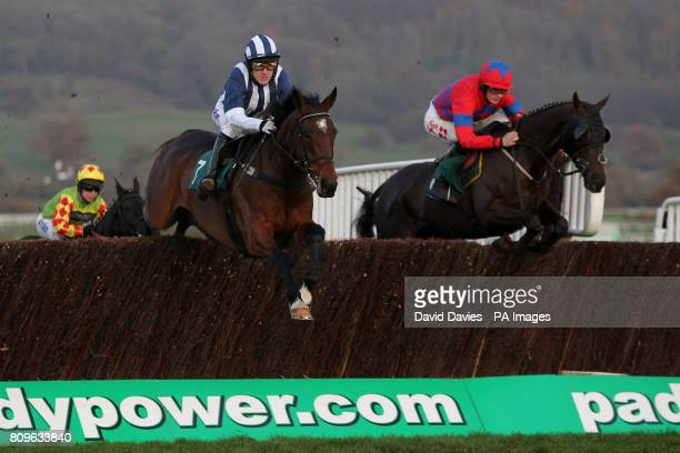 Jockey Tony McCoy on Teaforthree and Sam Twiston-Davies on Viking Blond during the Ultima Frontrunner In It Solutions Novices' Chase