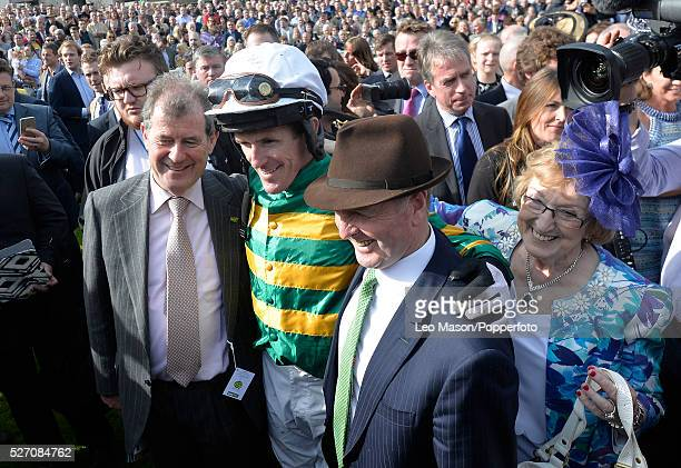 Jockey Tony McCoy pictured in the Parade ring for the last time with friends and family after his last race on his final day of racing as a jockey...