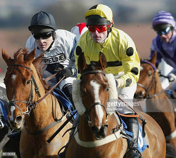 Jockey Tony McCoy races on Jardin Fleuri on his way to winning his first race on his comeback during the The Corve Novices Selling Hurdle Raceat...
