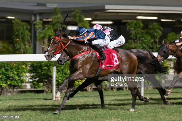 Jockey Umberto Rispoli riding Bank On Red wins the Race 6 High Island Handicap at Happy Valley Racecourse on November 8, 2017 in Hong Kong, Hong Kong.