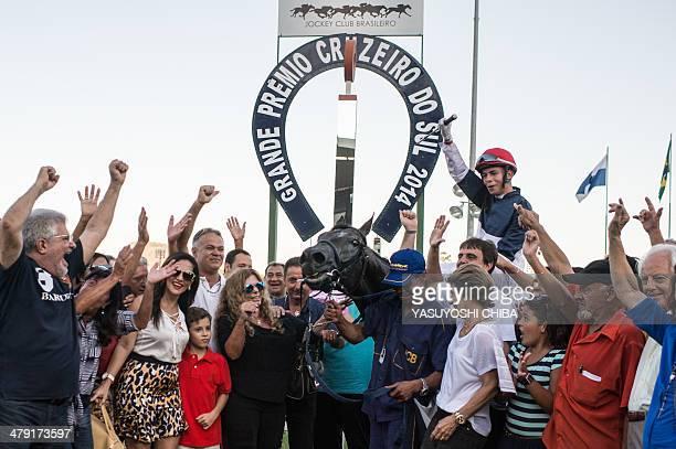 Jockey Vagner Borges celebrates on his race horse Bal A Bali after the winning in Rio de Janeiro's G1 derby Cruzeiro do Sul in Rio de Janeiro Brazil...