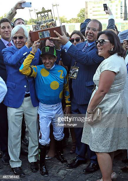 Jockey Victor Espinoza along with trainer Bob Baffert and owner of American Pharoah Ahmed Zayat along with his wife Joanne pose with the trophy after...