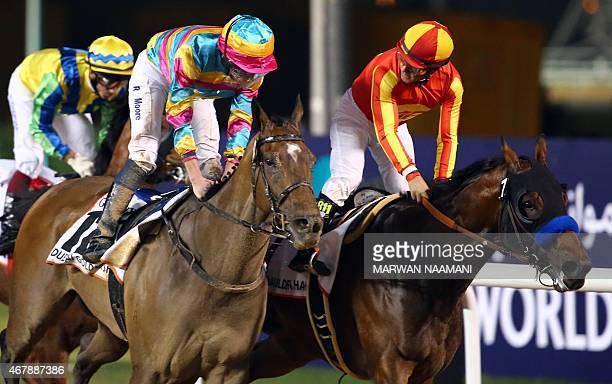 Jockey Victor Espinoza and his horse Secret Circle and jockey Ryan Moore and his horse Super Jockey ride during the Dubai Golden Shaheen race at the...