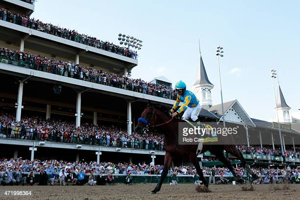 Jockey Victor Espinoza celebrates as he guides American Pharoah after crossing the finish line to win the 141st running of the Kentucky Derby at...
