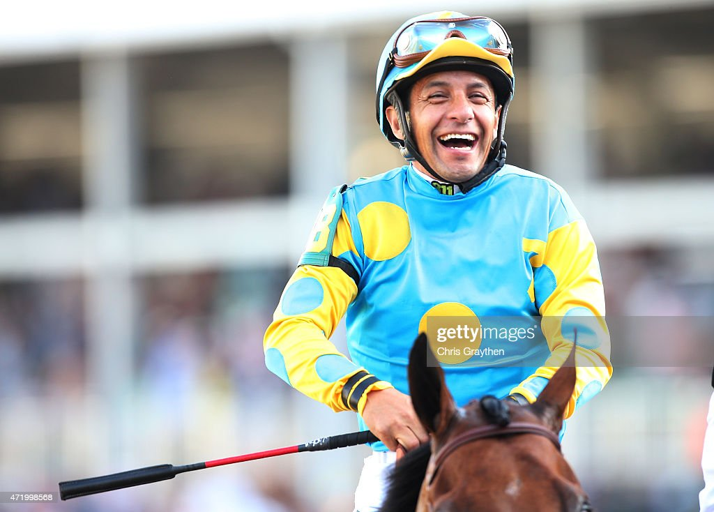 Jockey Victor Espinoza celebrates atop of American Pharoah #18 on his way to winners circle after winning the 141st running of the Kentucky Derby at Churchill Downs on May 2, 2015 in Louisville, Kentucky.