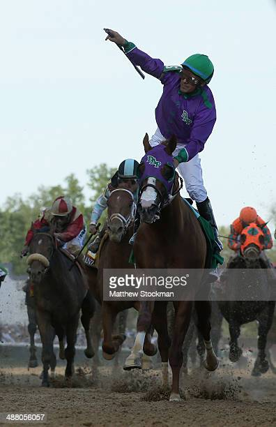 Jockey Victor Espinoza celebrates atop of California Chrome after crossing the finish line to win the 140th running of the Kentucky Derby at...