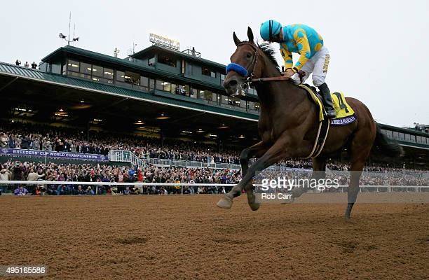 Jockey Victor Espinoza looks back after riding American Pharoah to victory in the Breeders' Cup Classic at Keeneland Racecourse on October 31, 2015...